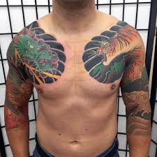 collection of 25 and tiger tattoos on chest