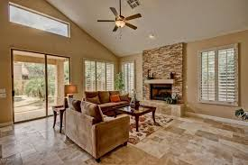 Travertine Fireplace Tile by Rustic Living Room With High Ceiling U0026 Stone Fireplace In