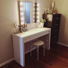 bedroom white wooden rectangle makeup table with mirror and light