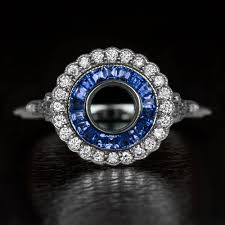 show me your art deco target diamond with sapphire halo rings