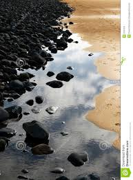 black rocks gold sand stock photo image of reflection 2191552