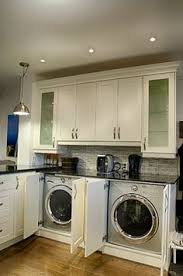 laundry in kitchen ideas lots of cupboard space in the kitchen that we don t really need
