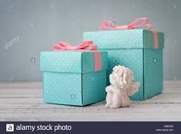 polka dot gift boxes blue polka dots gift boxes with statuette of angel on wooden stock