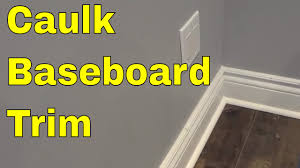 how to caulk baseboard trim tutorial for hiding gaps youtube