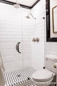 walk in bathroom ideas black and white walk in shower with glossy white beveled tiles
