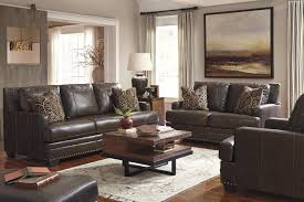 Ashley Leather Sofa And Loveseat Leather Match Ottoman With Nailhead Trim By Signature Design By