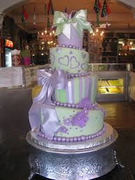 4 tier mad hatter wedding cake covered in mint u0026 lilac fondant