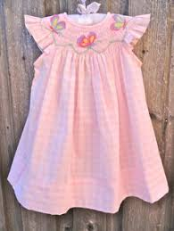 adorable baby smocked dress with dainty pink rosebuds