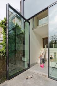 the glass door these are the largest glass pivoting doors in the world contemporist