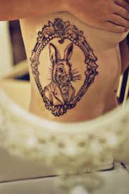 peter rabbits frame tattoo on thigh for girls