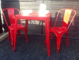 metal tolix style dining table with 2 chairs in red