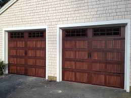 Overhead Door Installation by Clopay Walnut Finish Gallery Collection Garage Doors With Arched