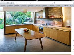 plywood kitchen doors copper splashback polished concrete floor