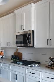 cabinet hardware for white kitchen cabinets white shaker kitchen cabinets accented with rubbed