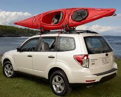 roof rack cross bars and 2 kayak racks for 2006 jeep liberty