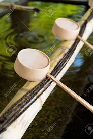 traditional japanese bamboo fountain dripping water stock photo