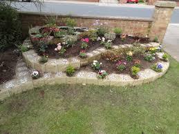 Garden Wall Retaining Blocks by Raised Flowerbed Created With Mortarless Reversible Interlocking