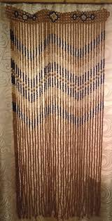 handmade and carved wooden beaded door room divider