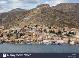 italian style houses and fishing boats pothia kalymnos greece