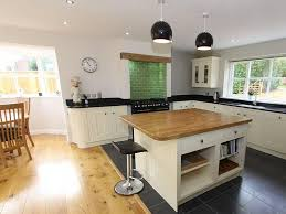 square island kitchen white wooden galley kitchen with square island boat
