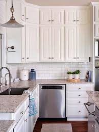 white kitchen cabinets with granite countertops painting cabinets before or after changing the backsplash
