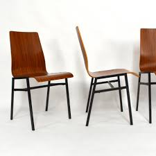 furniture stacking chairs in aluminum and birch plywood