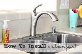 how to install a faucet in the kitchen how to install a kitchen faucet gluesticks
