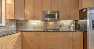 maple cabinets with granite countertops new caledonia granite countertops pictures cost pros and cons