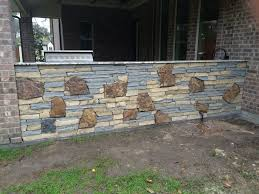 outdoor living space houston project features mixed stone