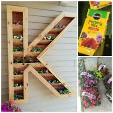 How To Make Planter Boxes by Remodelaholic Diy Monogram Planter Tutorial