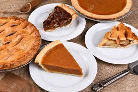 high angle view of whole pies and plates with slices traditional