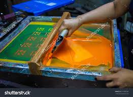 Orange Paint by Press Silkscreen Printing By Orange Paint Screen Stock Photo