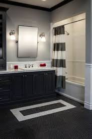 black and gray bathroom ideas built in bookshelves in hallway bathroom with industrial vct tile
