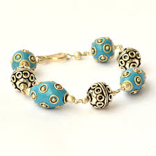 metal beads bracelet images Handmade bracelet having blue beads studded with metal rings jpg