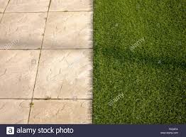 astroturf artificial grass astro turf meets paving slabs on a new build