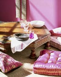 simple moroccan dining rom design with wooden dining table pink