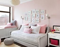 devyn tufted daybed cool cribs heather gray and pink girl s room features walls clad in pink plaid