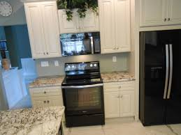 kitchens with black appliances and white cabinets luxurious home