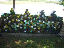 finally finished the wine bottle wall has lights in the bottles