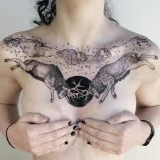 front of the shoulder tattoos interlocked elk in front of the kissing camels rocks at the garden