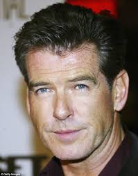 hair middle aged man dark pierce brosnan gene that gives people freckles dark hair and