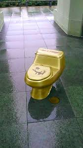 artists place golden toilets around central indiana for trump u0027s