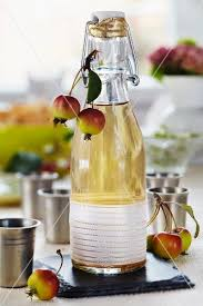 apple liqueur in a decorative flip top bottle with ornamental
