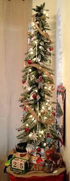 5 flocked slim tree from hobby lobby with a burlap ribbon