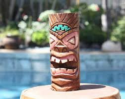 tiki surfboard tiki mask tiki statue wood carving tiki bar
