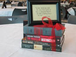 cute idea for graduation party use books as centerpiece with