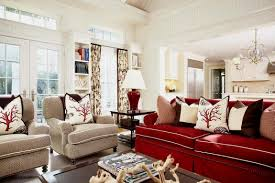 scarlet sofa and fabric armchairs with small pillows in a classic