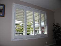 plantation shutters add a classic touch to the décor of any home