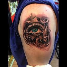 black and grey with color eye of ra done by artist