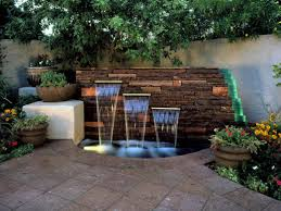patio pavers and small pond with outdoor wall fountain also